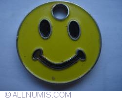 yellow smiley shopping cart token