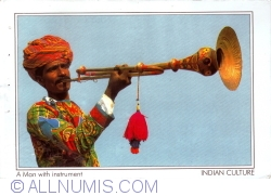 Image #1 of Indian Culture – An Indian Musician in Traditional Dres with his Instrument